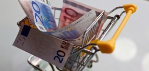Mini shopping cart filled with Euro bills