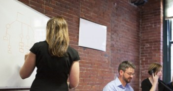 Business meeting woman drawing up plan on canvas