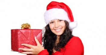 Woman dressed in red holding present in her hands