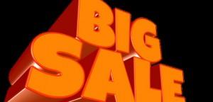 Orange big sale sign on black background