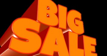Orange big sale sign on black background