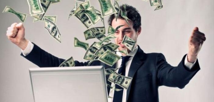 Man dollar bills computer