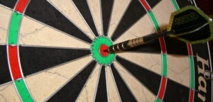 Darts board and arrow