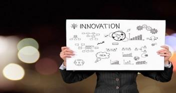 businessman holding an innovation graph
