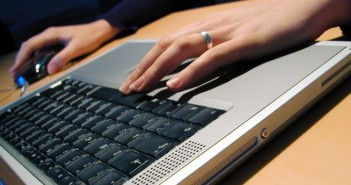 Woman typing on the laptop