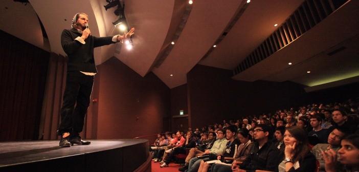 Man holding presentation crowd