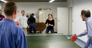 Employees playing ping-pong