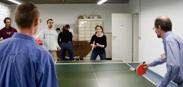 Employees playing ping-pong