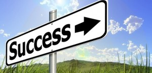 Success sign blue skies green pastures
