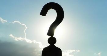 black silhouette blue skies question mark