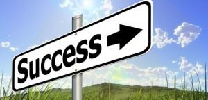 Success sign green pastures blue sky