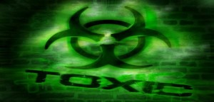 Toxic sign on black and green background