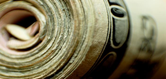 Dollar bills roll